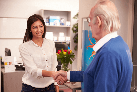 audiologist shaking a customer's hand