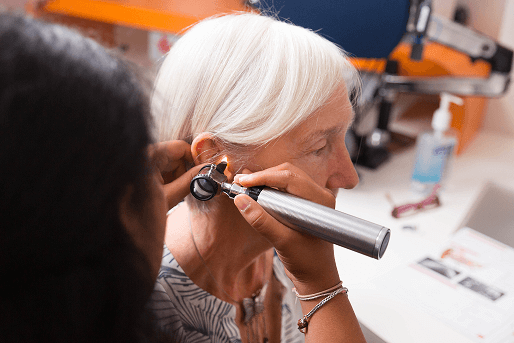 audiologist showing a patient the best hearing aids