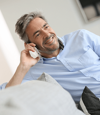 man talking on phone with a bluetooth hearing aid